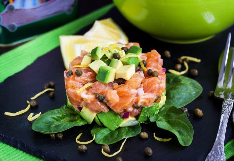 Salmon and avocado tartare stock images