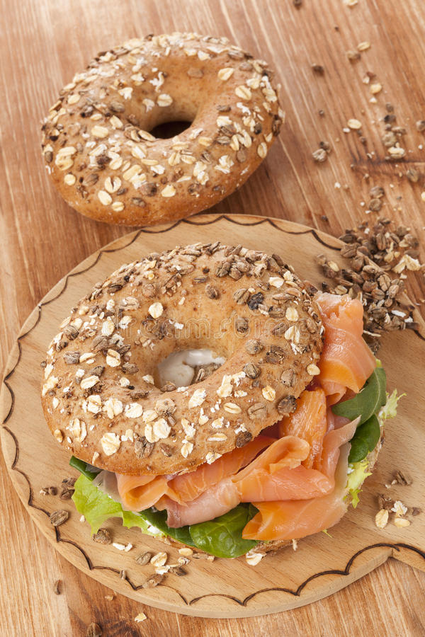 Salmon bagel. Delicious bagel with smoked salmon. Traditional amercan healthy eating stock photo