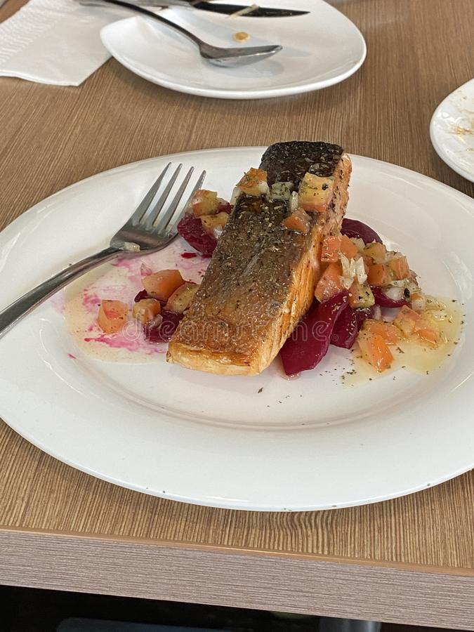 Salmon with beetroot in lime and honey sauce stock photos