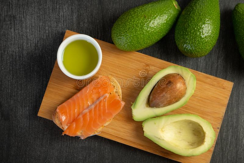 Salmon on bread slices gourmet appetizer with avocado. Fresh salmon   and avocado sandwich. Healthy food concept. stock image
