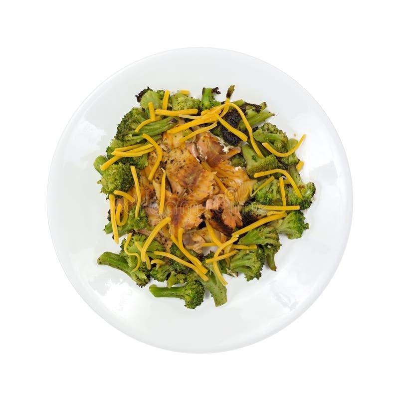 Salmon Broccoli On White Plate con formaggio immagini stock
