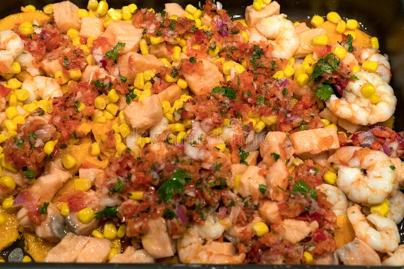 Salmon ceviche with red pepper, coriander, corn and lime royalty free stock photos