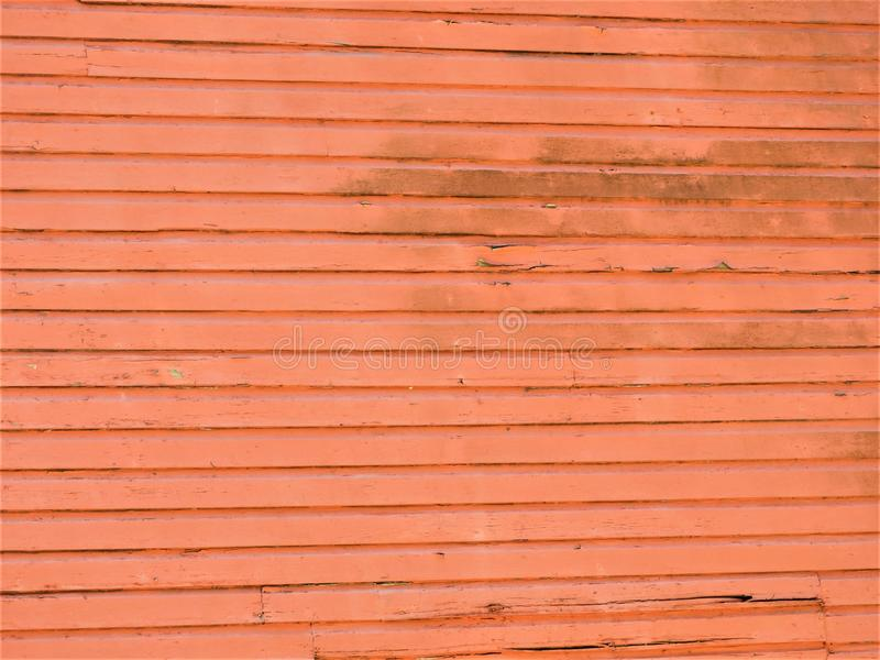 Salmon colored wooden wall to an abandoned building. This would be a great background stock photos