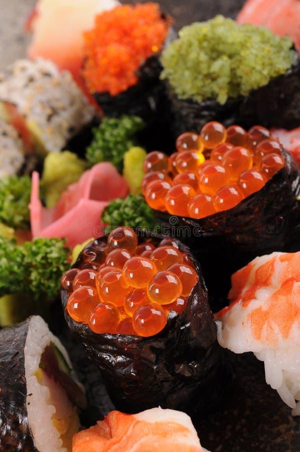 Salmon eggs sushi stock images