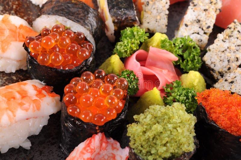Salmon eggs sushi - Ikura sushi royalty free stock photo