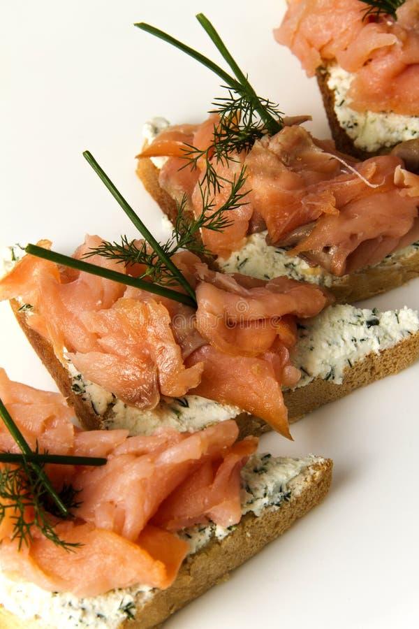 Salmon fillet on bread slice stock image