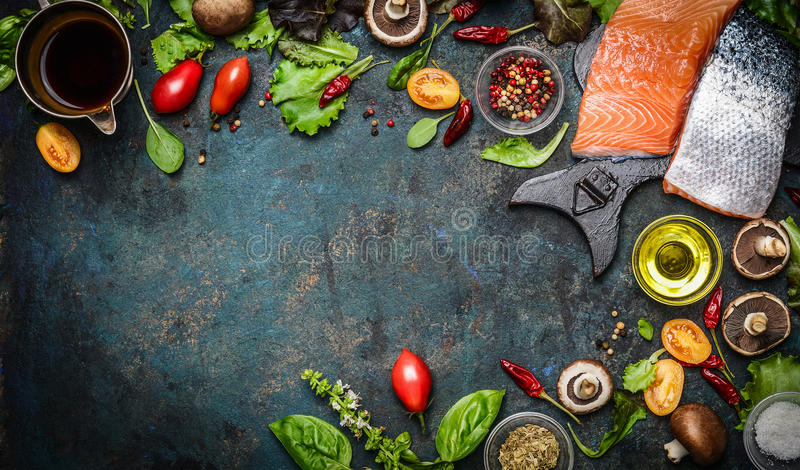 Salmon fillet with fresh ingredients for tasty cooking on rustic background, top view, banner. Healthy food concept royalty free stock photo