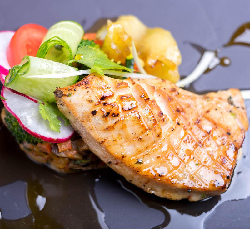 Salmon fillet grilled with vegetable salad stock photos