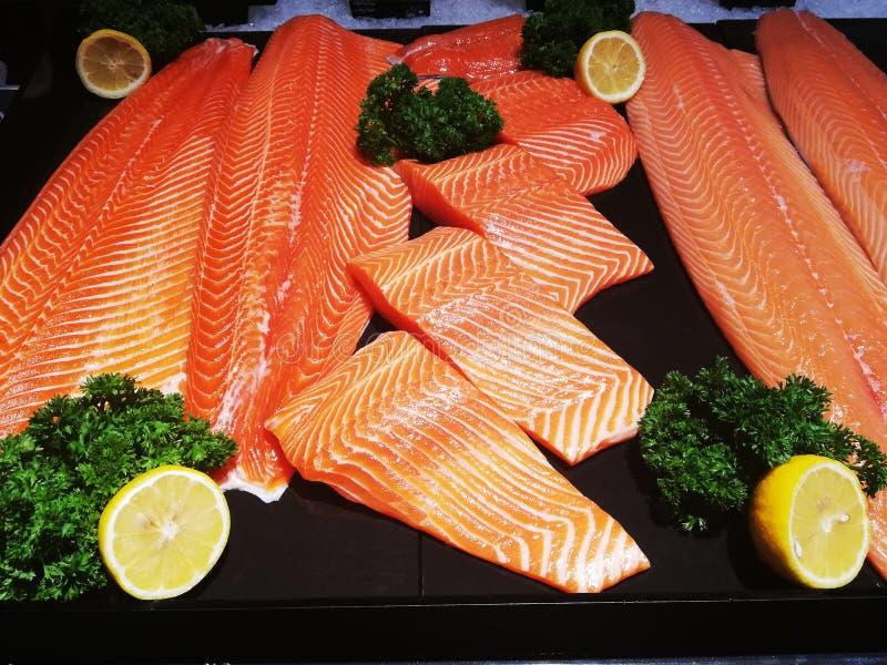 Salmon fillets frozen on ice royalty free stock photo