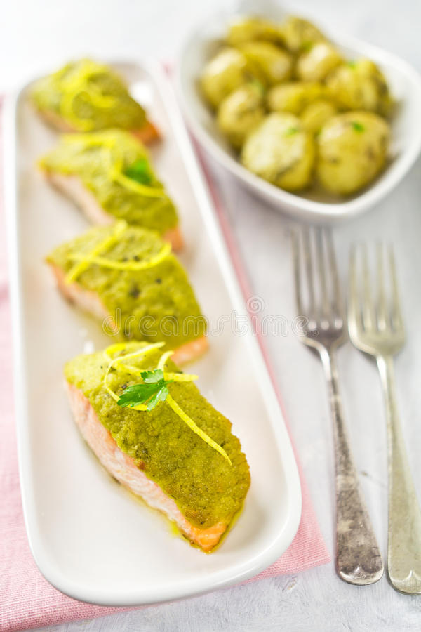 Salmon fillets. With green pesto and baby potatoes stock photo