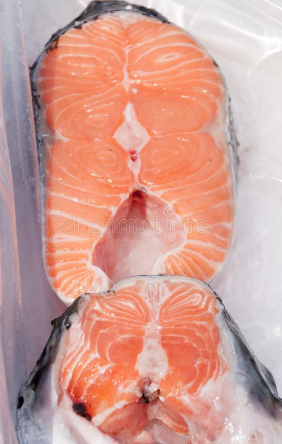 Salmon fillets on ice stock images