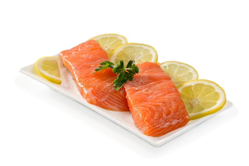 Salmon Fillets. With lemon slices on a white background stock images