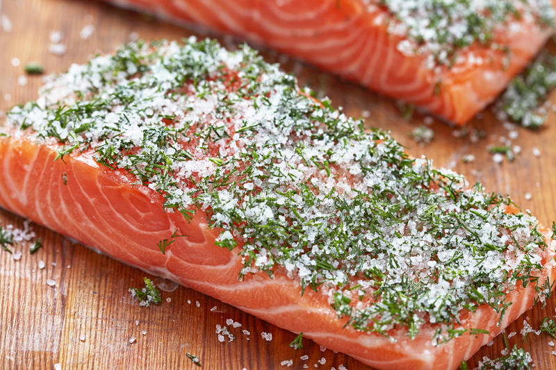 Salmon fillets with salt, sugar and dill. See my other works in portfolio royalty free stock image