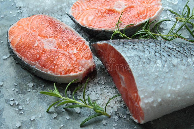 Salmon fillets. With spices - salt and fresh rosemary stock images