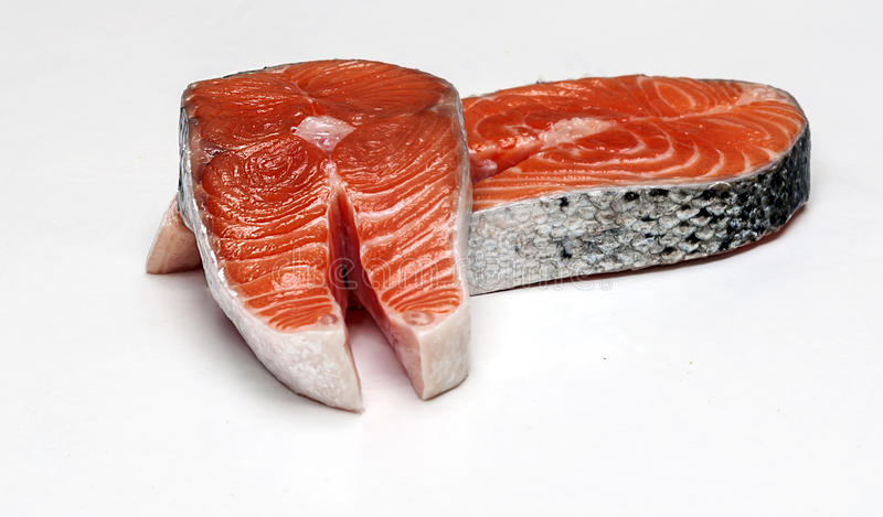 Salmon fillets. Surrounded by white background stock images