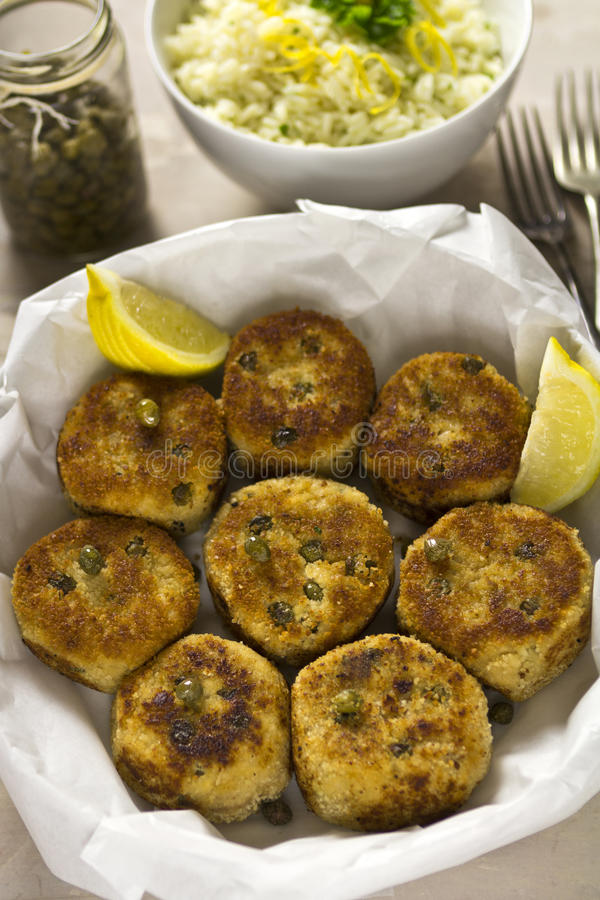 Salmon fish cakes with lemon royalty free stock photos