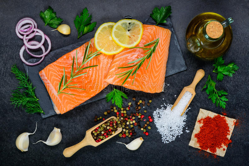 Salmon Fish Fillet with Cooking Ingredients royalty free stock photos