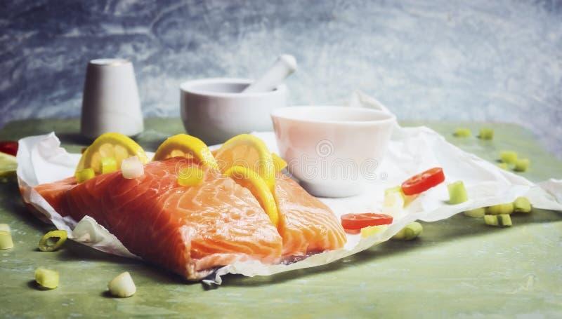 Salmon fish with lemon, cooking royalty free stock photos