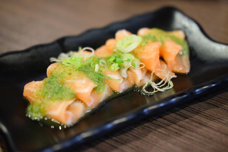 Salmon fish seafood sashimi mix with Thai sauce stock photos