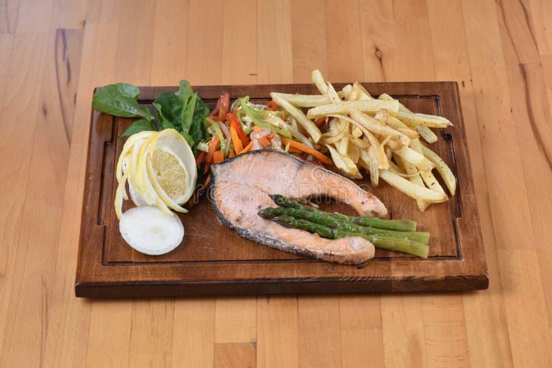 Salmon Fish. Served with potato, lemon and salad stock photography