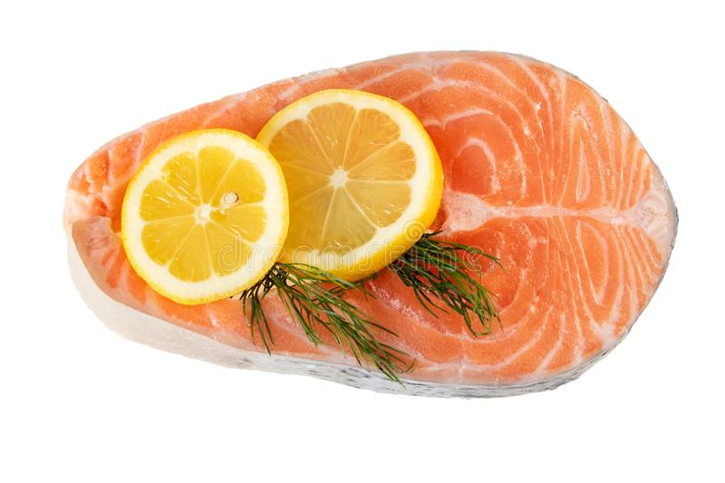 Salmon fish steak raw uncooked with lemon slice on white Flat lay, top view stock images