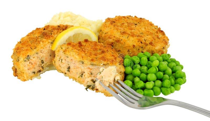 Salmon Fishcake And Mashed Potato mål royaltyfri foto