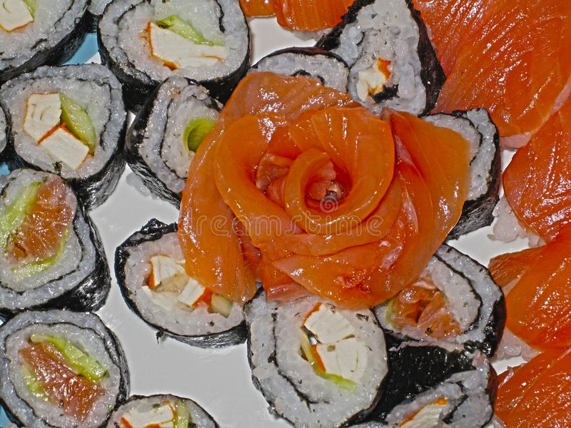 Flower of salmon laid out on the rolls royalty free stock image