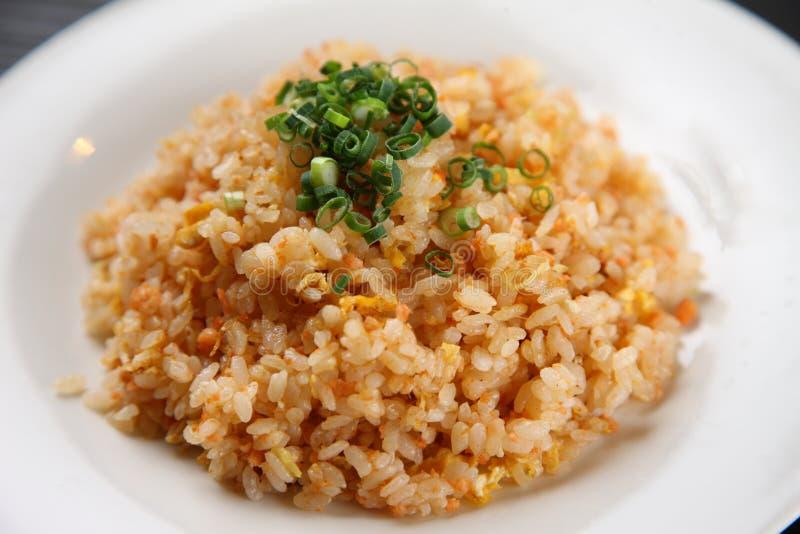 Salmon fried rice. Studio shot of salmon fried rice on black background stock photo