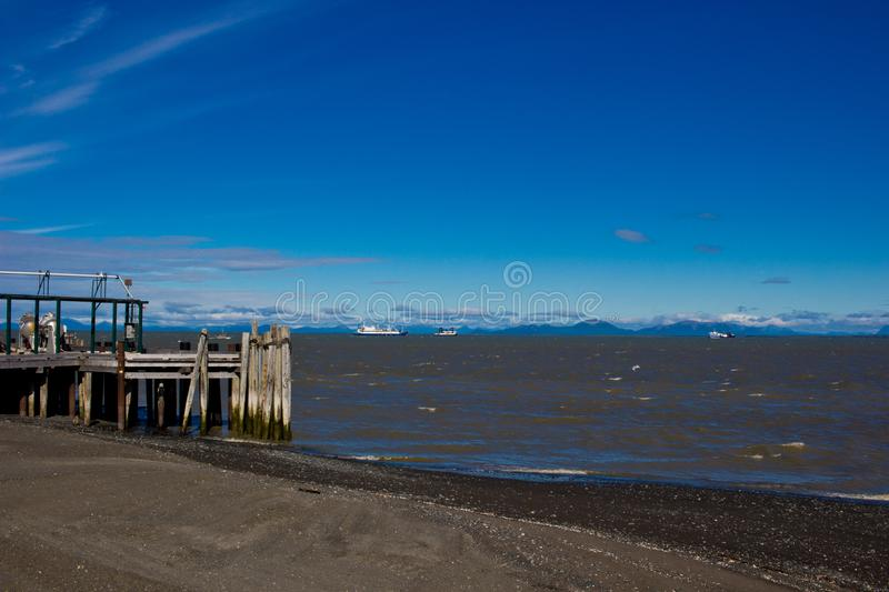 Salmon gillnet fleet and tenders in Bristol Bay off Clarks Point on a windy day. Partly cloudy with bright blue sky royalty free stock photography