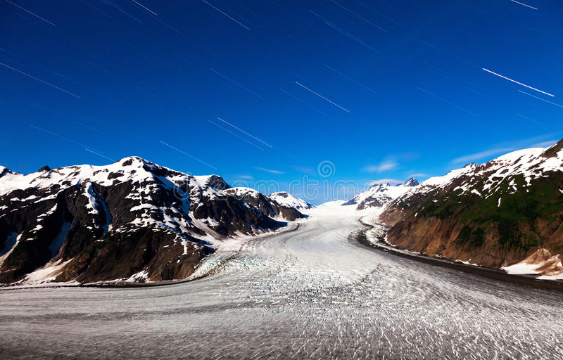 Salmon Glacier and star trail. Salmon Glacier at Hyder Alaska, moonlight and star trail royalty free stock image