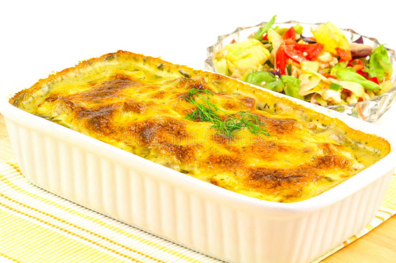 Salmon gratin and salad royalty free stock photography