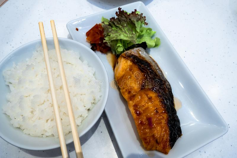 Salmon grilled sea food, rice salads. Japanese grilled salmon food isolated stock photography