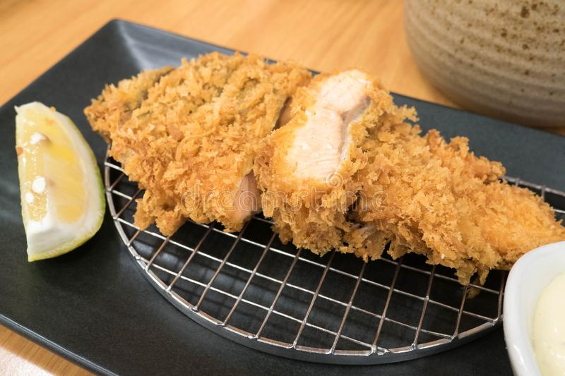 Salmon katsu like a famous pork cutlet Tonkatsu on black plate royalty free stock image