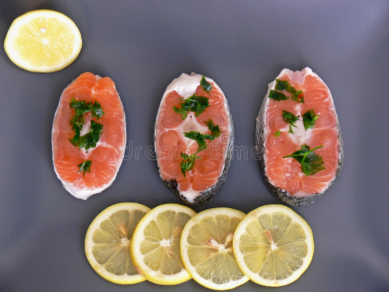 Salmon and lemon on plate royalty free stock photos