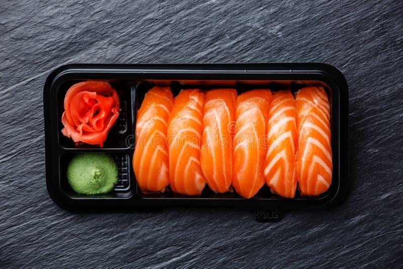 Salmon nigiri sushi in plastic box stock photo