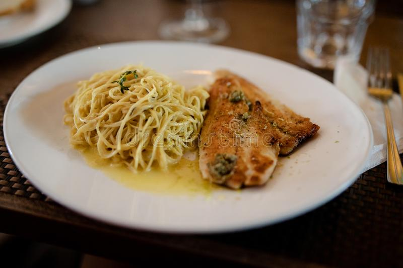 Salmon with pasta royalty free stock image