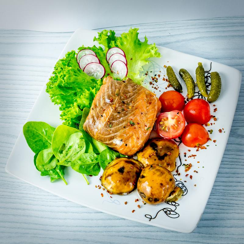 Salmon pocket with vegetables royalty free stock image