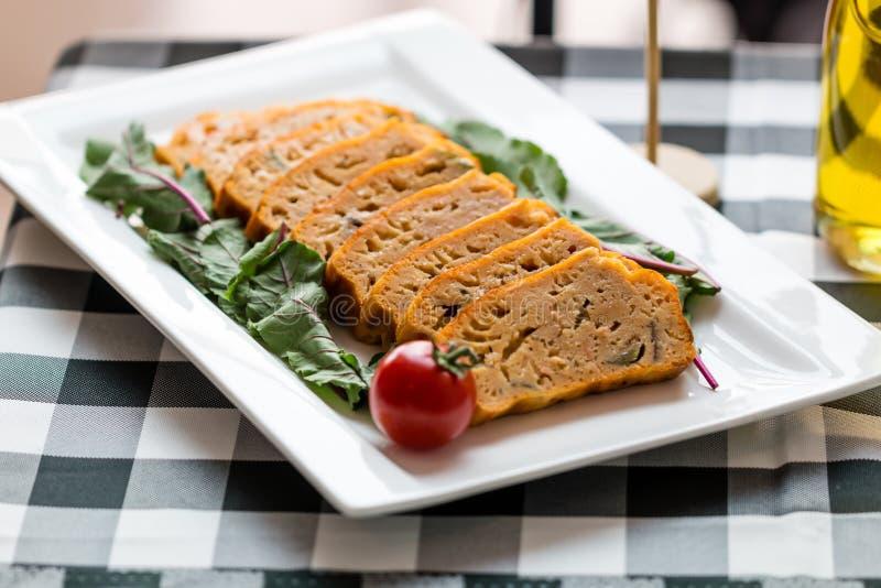 Salmon Ratatouille Savary Cake. With tomato royalty free stock photo