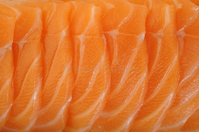 Salmon raw sashimi. On background stock photo