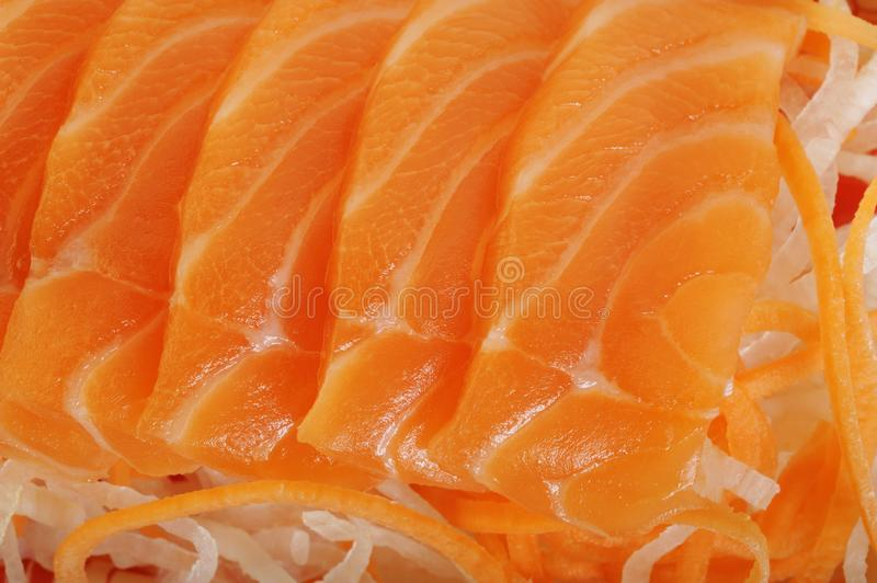 Salmon raw sashimi. On background royalty free stock photo