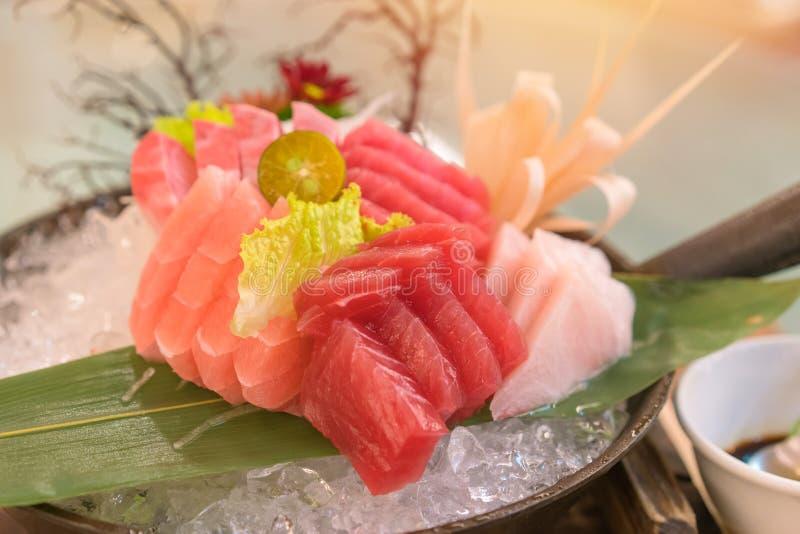 Salmon raw sashimi sushi with shrimp on plate, japanese food royalty free stock images