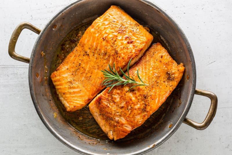 Salmon roast steak. Salmon steak in roast pan on white concrete. Background stock photography