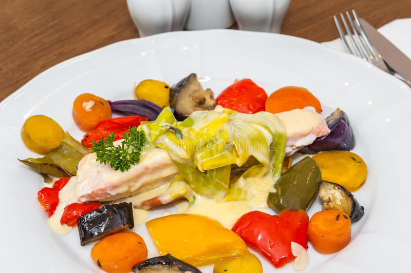 Salmon with roasted vegetables stock photo