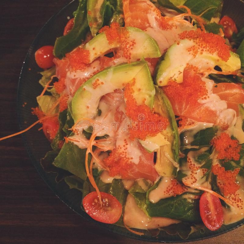 salmon salad with avocado stock photo