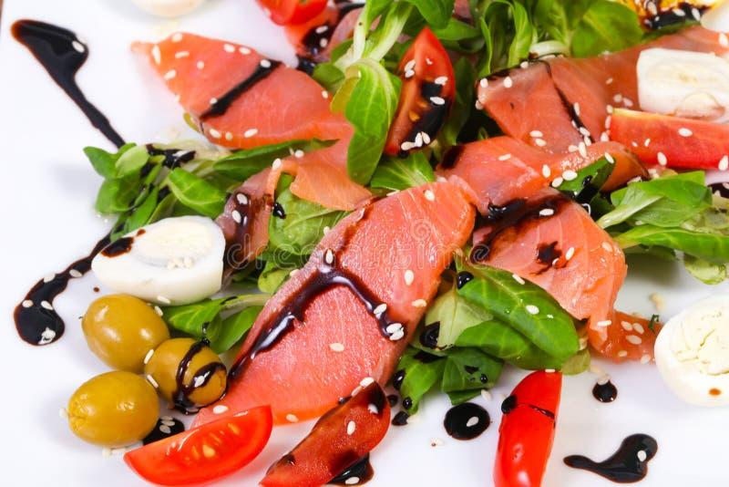 Salmon salad with eggs stock photography
