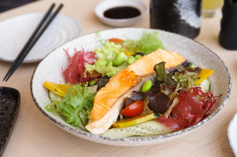 Salmon salad. A Japanese appetizer of salmon salad with edamame or Japanese green soybean. Selective focus on the Ikura or salmon royalty free stock image