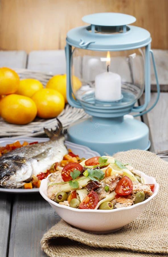 Salmon salad on wooden table
