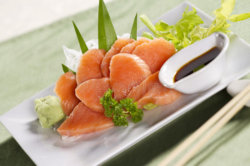 Salmon sashimi. Fresh salmon japanese food decorated sashimi with wasabi and soy sauce royalty free stock photo
