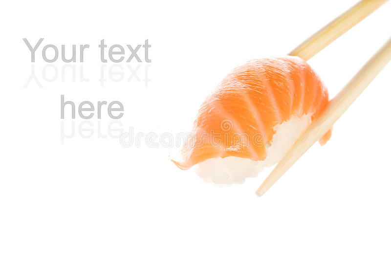 Salmon sashimi. Wooden chopsticks holding salmon sashimi stock photos