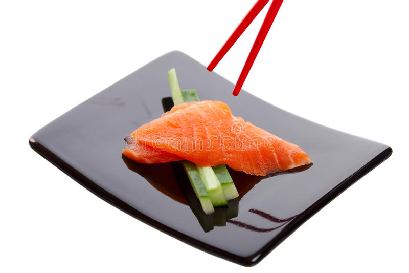 Salmon Sashimi. Japanese sushi dish called Salmon Sashimi. Shot on white background royalty free stock image